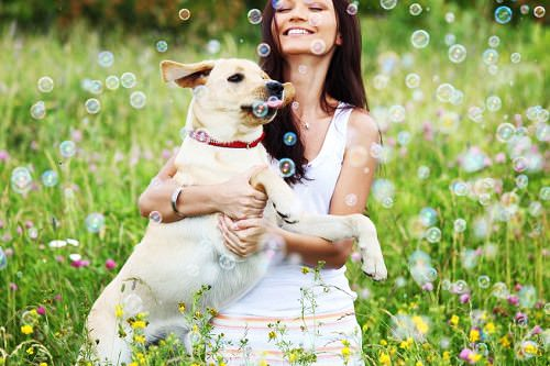 Woman with dog and bubbles