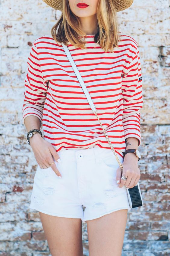 Red striped shirt, white jean shorts, brimmed hat
